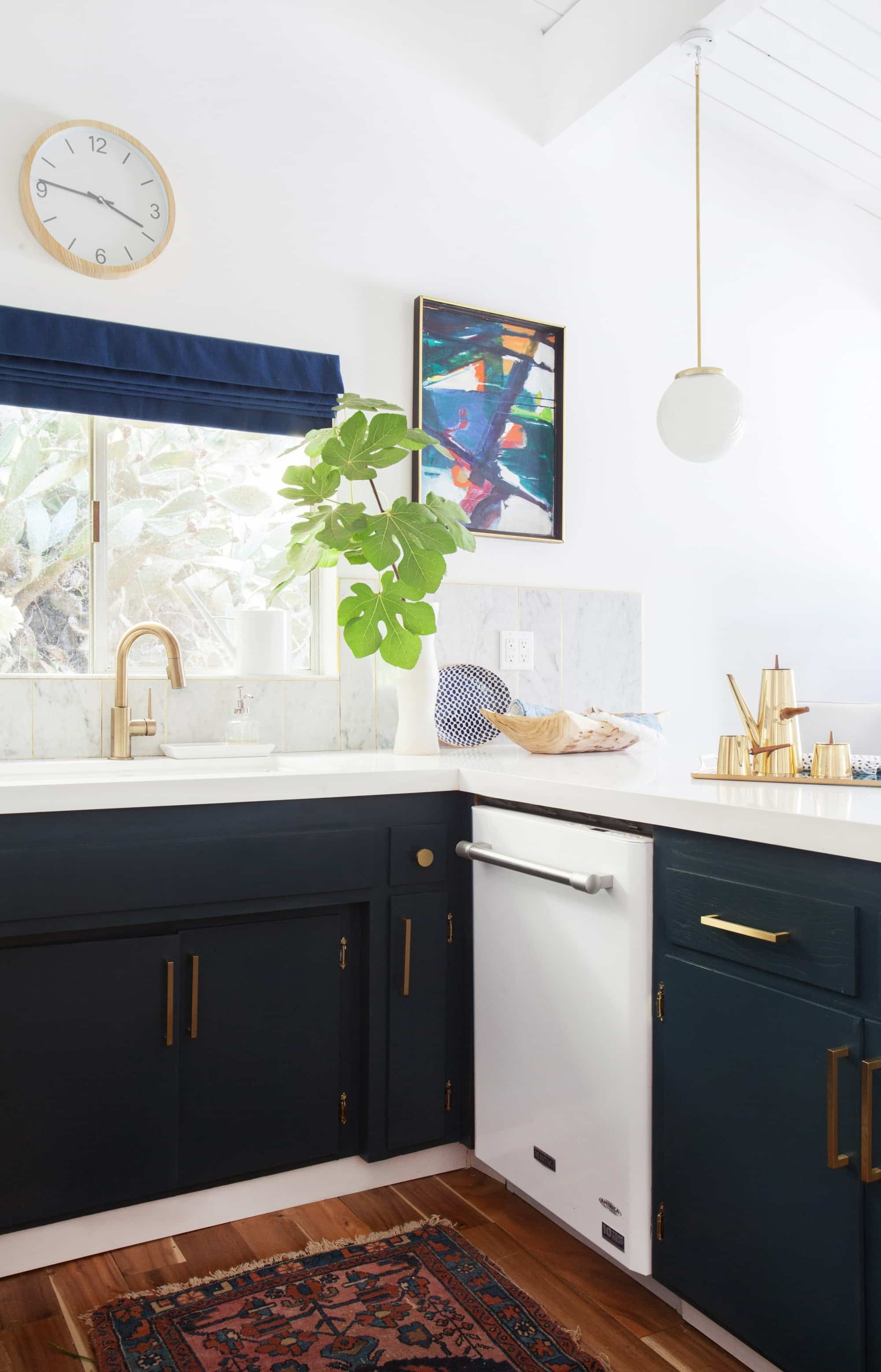 home remodeling trends: gold cabinet hardware-kitchen_after_emily-henderson-blue-white-brass-appliances