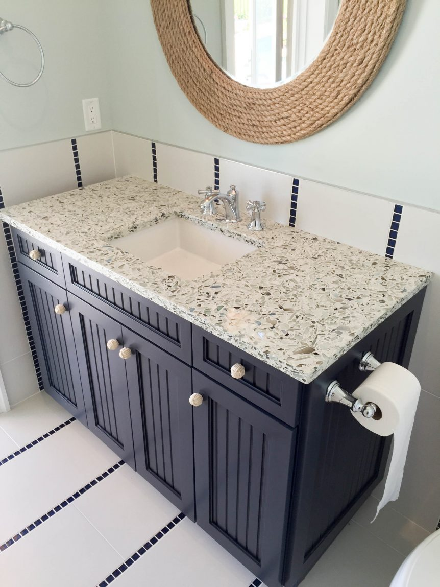 navy blue vanity cabinet with recycled glass countertop