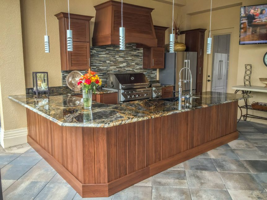 Naturekast outdoor kitchen with twin eagles grilling accessories and granite countertops.